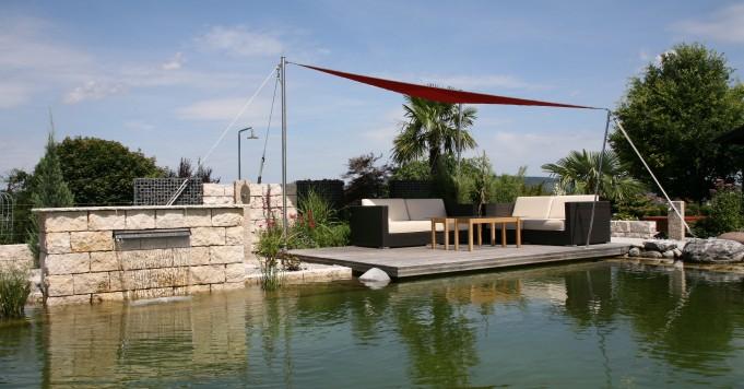 Schröer Garten- und Landschaftsbau zeigt einen Garten mit Schwimmteich